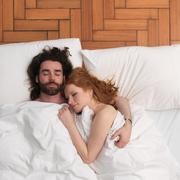 Couple sleeping in bed Stock Photos