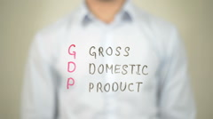 GDP, Gross Domestic Product,  Man writing on transparent screen Stock Footage