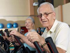 Seniors training at gym Stock Photos