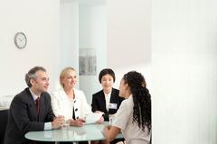 An interview in front of a panel Stock Photos