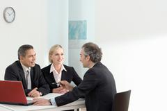 A business discussion with laptop - stock photo
