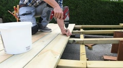 Closeup of man using electric drill for wooden deck Stock Footage