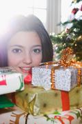 Girl, 14 behind pile of presents - stock photo