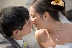 Bridal couple almost kissing. Stock Photos