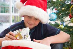 Boy, 10 holding present Stock Photos