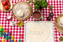 cut out letters with dough - stock photo