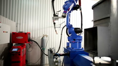 Production of metal sauna stoves. The robot does the welding of a sauna stove. Stock Footage