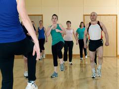 Aerobic exercise at gym Stock Photos