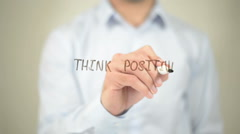 Think Positive,  Man writing on transparent screen Stock Footage