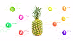 Vitamins fly out of the pineapple with the formulas and nutrition facts Stock Footage