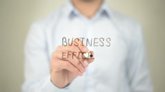 Business Efficiency,  Man writing on transparent screen - stock footage