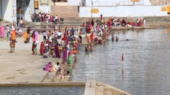 Indian people ritual washing in sacred lake. Pushkar, India - stock footage