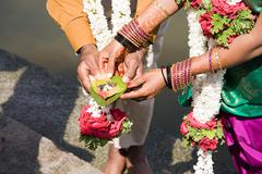 Couple holding puja in indian wedding ceremony Stock Photos