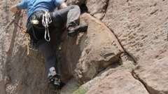 Climber wearing safety harness and climbing equipment outdoor Stock Footage