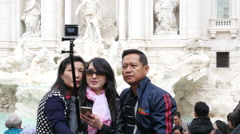 Asian family tourists take selfie on ancient antique columns of Rome Empire - stock footage