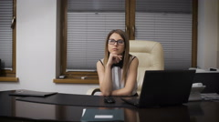 Secretary Girl distracted from work. She sits at a desk and dreaming of vacation Stock Footage