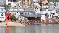 Indian people ritual washing in sacred lake. Pushkar, India Stock Footage