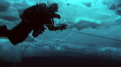 Divers explore the underwater world of the Arctic Ocean at the North Pole. Stock Footage