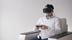Happy Young Man with Virtual Reality Headset or 3d Glasses with Controller Stock Footage