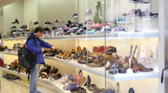 People shopping in Rome Italy - fashion shoes footwear boutique shelves interior Stock Footage