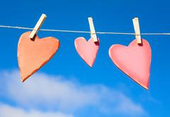 Three hearts on a washing line - stock photo