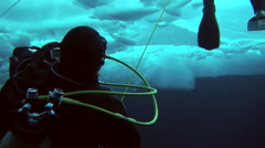 Divers rise up from the depths of the Arctic Ocean at the North Pole. Stock Footage