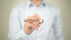 Warning,  Man writing on transparent screen - stock footage