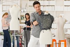 Fashion designers at work - stock photo