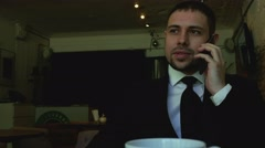 Business call in restaraunt - stock footage