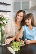 Mother and daughter flower arranging Stock Photos