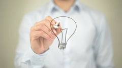 Idea, Glowing Bulb Concept,  Man writing on transparent screen Stock Footage