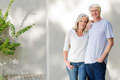 Middle aged couple standing outside on deck Stock Photos