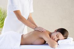 Young woman receiving massage - stock photo