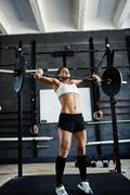 Strong woman lifting heavy barbell Stock Photos