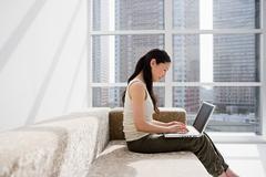 Japanese woman telecommuting Stock Photos