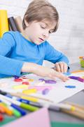Small boy and his creative hobby - stock photo