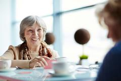 Smiling senior female spending time with her friend Stock Photos
