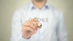 Customer Care,  Man writing on transparent screen Stock Footage