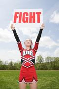 Cheerleader with fight sign Kuvituskuvat