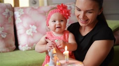 Birthday cake, Baby and mother celebrate first birthday holiday - stock footage