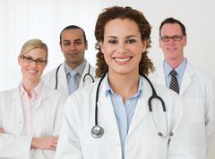 Portrait of four doctors Stock Photos