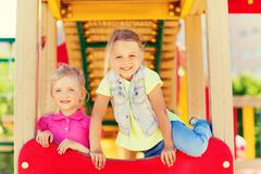 Happy kids on children playground Kuvituskuvat