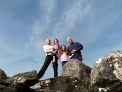 Mature couple children standing on rocks Stock Photos