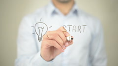 Start Up, Concept,  Man writing on transparent screen Stock Footage