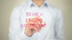 Search Engine Optimization,  Man writing on transparent screen Stock Footage