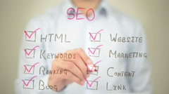 Seo, Check List,  Man writing on transparent screen Stock Footage