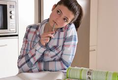 Girl 14, studying at home - stock photo
