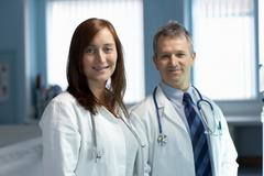 Portrait of two doctors - stock photo
