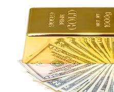 gold bullion and dollar bills - stock photo