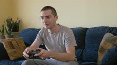4K Young Man Using a Video Game Controller to Play Stock Footage